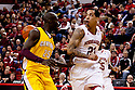 20 December 2011: Bo Spencer #23 of the Nebraska Cornhuskers passes behind Olivier Mbaigoto #25 of the Central Michigan Chippewas to Toney McCray #0  during the first half at the Devaney Sports Center in Lincoln, Nebraska. Nebraska defeated Central Michigan 72 to 69.