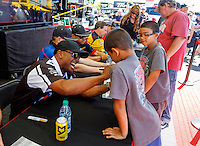 Jun 10, 2016; Englishtown, NJ, USA; NHRA top fuel driver Antron Brown signs autographs during qualifying for the Summernationals at Old Bridge Township Raceway Park. Mandatory Credit: Mark J. Rebilas-USA TODAY Sports