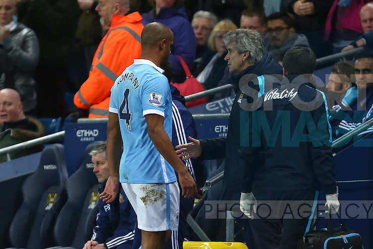 Vincent Kompany with Manuel Pellegrini, manager of Manchester City after he is substituted off - Manchester City vs Sunderland - Barclays Premier League - Etihad Stadium - Manchester - 26/12/2015 Pic Philip Oldham/SportImage