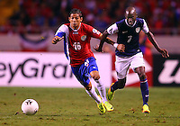 SAN JOSE, COSTA RICA - September 06, 2013: DaMarcus Beasley (7) of the USA MNT goes for a loose ball with Cristian Gamboa (16) of the Costa Rica MNT during a 2014 World Cup qualifying match at the National Stadium in San Jose on September 6. USA lost 3-1.