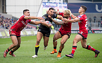 Picture by Allan McKenzie/SWpix.com - 07/04/2018 - Rugby League - Betfred Super League - Salford Red Devils v Warrington Wolves - AJ Bell Stadium, Salford, England - Warrington's Ryan Atkins fends off the tackles from Salford's Derrell Olpherts, Junior Sa'u and Jake Shorrocks.