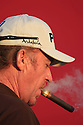 JIMENEZ Miguel Angel (ESP) smokes a cigar after the first round of the Commercialbank Qatar Masters Presented by Dolphin Energy played at Doha Golf Club on 22nd January 2009 in Doha, Qatar....