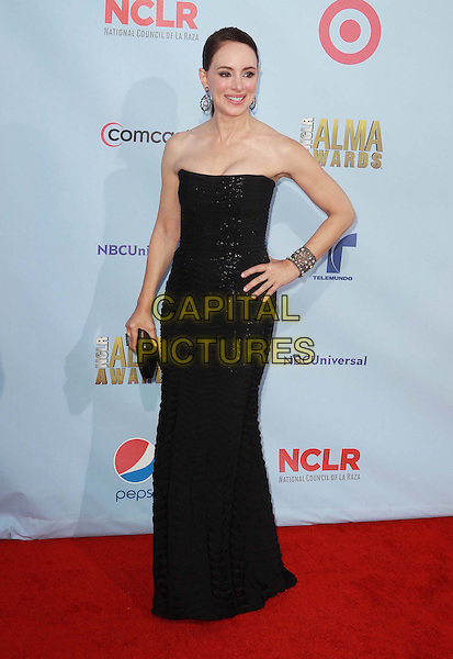Madeleine Stowe.2012 NCLR ALMA Awards - arrivals, held at The Pasadena Civic Auditorium, Pasadena, California USA..16th September 2012.full length black dress strapless clutch bag bracelet hand on hip.CAP/ADM/KB.©Kevan Brooks/AdMedia/Capital Pictures.