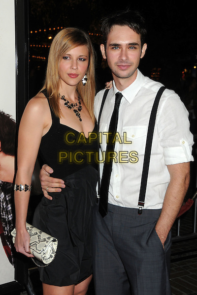 "GUEST & SCOTT MECHLOWICZ.""Waiting For Forever"" Los Angeles Premiere held at Pacific Theatres at The Grove, Los Angeles, California, USA, .1st February 2011..half length white shirt tie black dress braces grey gray trousers clutch bag  .CAP/ADM/BP.©Byron Purvis/AdMedia/Capital Pictures."