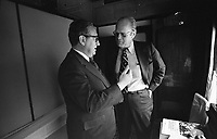 Photograph of President Gerald Ford and Secretary of State Henry Kissinger conferring on the train ride to Vladivostok. NOV 1974