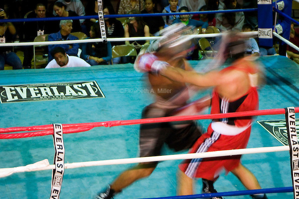 "Two boxers in the ring at ""Brawl In The 'Burg,"" a night of amateur boxing sponsored by the Brotherhood Boxing Club and the Lighthouse Tabernacle."