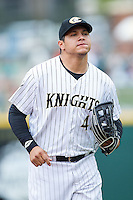 Charlotte Knights right fielder Avisail Garcia (43) jogs off the field between innings of the game against the Pawtucket Red Sox at BB&T Ballpark on August 10, 2014 in Charlotte, North Carolina.  The Red Sox defeated the Knights  6-4.  (Brian Westerholt/Four Seam Images)