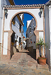 Moorish archway architectural feature and alleyway in the Andalusian village of Comares, Malaga province, Spain
