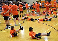 Westside Eagle Observer/MIKE ECKELS<br /> <br /> Several future Gravette Lions basketball stars performs some of the drills they learned in an earlier youth basketball camp. The demonstration was held between the varsity girls and boys contest at the competition gym Jan. 7.