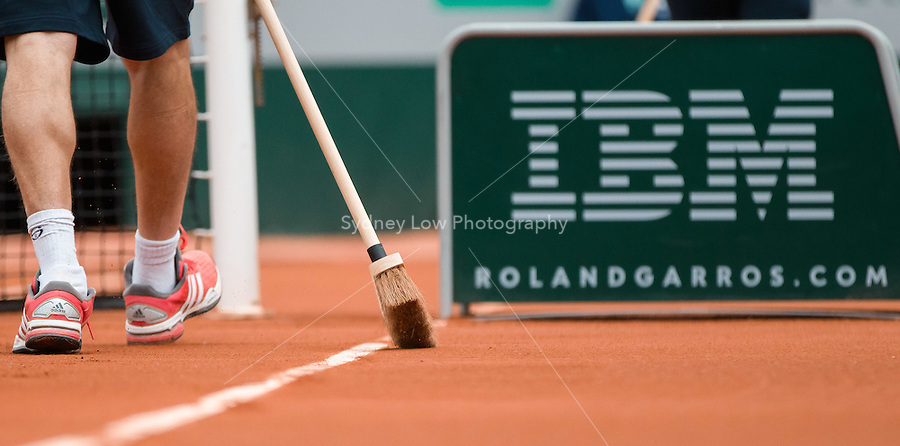 May 26, 2015: The court is swept during the 1st round match between David Ferrer (ESP) and Lukas Lacko (SVK) on day three of the 2015 French Open tennis tournament at Roland Garros in Paris, France. Sydney Low/AsteriskImages