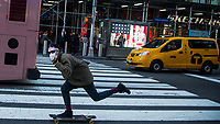 NEW YORK, NEW YORK - MARCH 4: A man wears a face mask as skates around Times Square on March 4, 2020 in New York City. The coronavirus cases in New York has been doubled to 22. Eight new victims testing positive state wide Gov. Cuomo announced Thursday.. (Photo by Pablo Monsalve / VIEWpress)