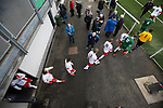 Spartans 1 University of Stirling 0, 12/03/2016. Ainslie Park, Scottish Lowland League. The teams emerging from the dressing rooms before the Spartans (in white) versus University of Stirling Scottish Lowland League match at Ainslie Park, Edinburgh. The match was one of six attended by members of GroundhopUK over the weekend to accommodate groundhoppers, fans who attempt to visit as many football venues as possible. Around 100 fans in two coaches from England participated in the 2016 Lowland League Groundhop and they were joined by other individuals from across the UK which helped boost crowds at the six featured matches. Photo by Colin McPherson