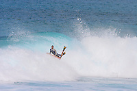 World Champion bodyboarder, Jeff Hubbard from Kauai, prepares to land an air reverse off of the end section at Off the Wall on Oahu's North Shore. Jeff Hubbard has also graduated Hawaii Pacific University with both bachelors and masters degrees.