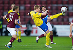 Hearts v St Johnstone...03.12.11   SPL .Liam Craig clears from Adrian Mrowiec.Picture by Graeme Hart..Copyright Perthshire Picture Agency.Tel: 01738 623350  Mobile: 07990 594431