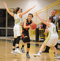 NWA Democrat-Gazette/ANDY SHUPE<br /> Tori Foster (center) of Gravette attempts to pass out of a trap as Aspen Campbell (00 and Madi Rust of Pottsville defend Wednesday, Feb. 24, 2016, during the first half of play in the 4A North Regional Tournament in Tiger Arena in Prairie Grove. Visit nwadg.com/photos to see more photographs from the game.