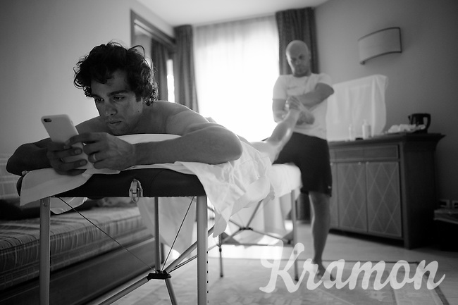 Michael Matthews (AUS/Orica-GreenEDGE) on the massage-table checking his Instagram &amp; messages after the stage<br /> <br /> 2015 Giro<br /> st4: Chiavari - La Spezia (150km)