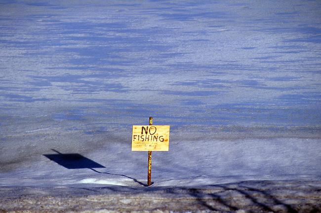 "Homemade Sign: ""No Fishing Closed for the Season"", On Frozen Pond, La Plata County, Colorado, USA, North America"
