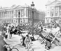 Crowds of Parisians celebrating the entry of Allied troops into Paris scatter for cover as a sniper fires from a building on the place De La Concorde.  Although the Germans surrendered the city, small bands of snipers still remained.  August 26, 1944.  Verna. (Army)<br /> NARA FILE #:  111-SC-193008<br /> WAR & CONFLICT BOOK #:  1057