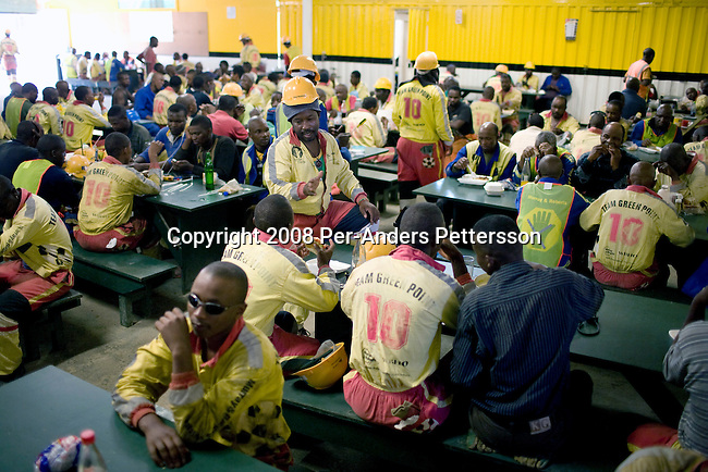 CAPE TOWN, SOUTH AFRICA - FEBRUARY 18: Unidentified construction workers eat in their lunchroom during a lunch break on February 18, 2008 at Green Point Stadium in Cape Town, South Africa. About 1500 workers construct the new stadium that is built for the 2010 World Cup Soccer tournament held in South Africa. The stadium will have a retractable roof and a capacity of 68 000. (Photo by: Per-Anders Pettersson Reportage by Getty Images)..
