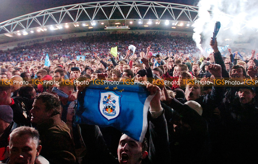 Town fans invade the pitch after the final whistle - Huddersfield Town vs MK Dons - nPower League One Play-Off Semi-Final Second Leg at the Galpharm Stadium - 15/05/12 - MANDATORY CREDIT: Anne-Marie Sanderson/TGSPHOTO - Self billing applies where appropriate - 0845 094 6026 - contact@tgsphoto.co.uk - NO UNPAID USE.