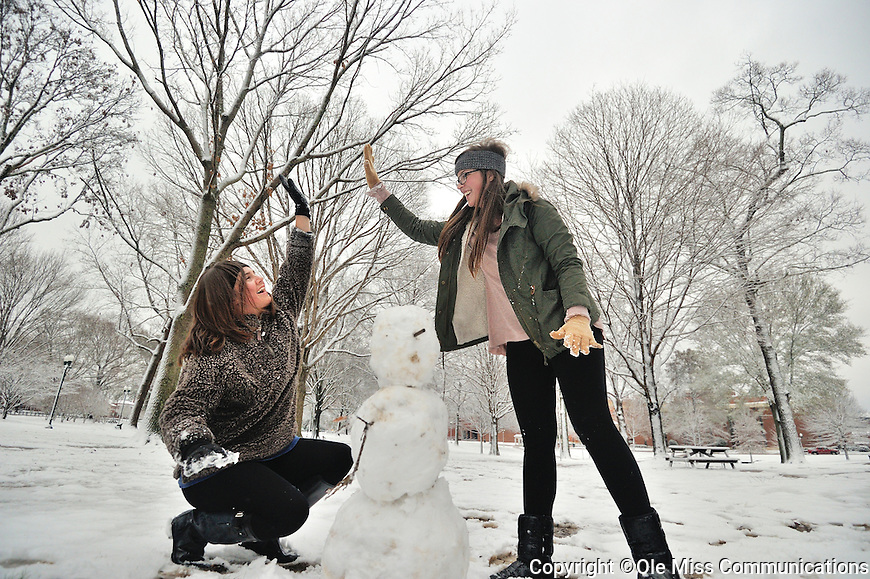 Danielle McGrew, left, and Carly Thomas celebrate their successful snowman. Photo by Kevin Bain/Ole Miss Communications
