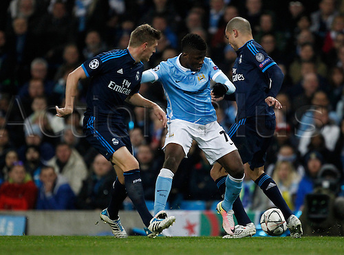 26.04.2016. The Etihad, Manchester, England. UEFA Champions League. Manchester City versus Real Madrid. City substitute Manchester City striker Kelechi Iheanacho tries to go past Real Madrid midfielder Toni Kroos and Real Madrid defender Pepe.