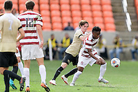 Houston, TX - Friday December 11, 2016: Hunter Bandy (20) of the Wake Forest Demon Deacons and Bryce Marion (7) of the Stanford Cardinal battle for control of the ball at the NCAA Men's Soccer Finals at BBVA Compass Stadium in Houston Texas.