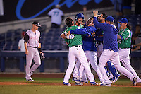 Tulsa Drillers pinch hitter Chase De Jong (34) is mobbed by teammates including Brandon Trinkwon (8), Alex Verdugo (hoodie), Tyler Ogle and Ralston Cash after a walk off bunt due to an error during a game against the Arkansas Travelers on April 28, 2016 at ONEOK Field in Tulsa, Oklahoma.  Tulsa defeated Arkansas 5-4.  (Mike Janes/Four Seam Images)
