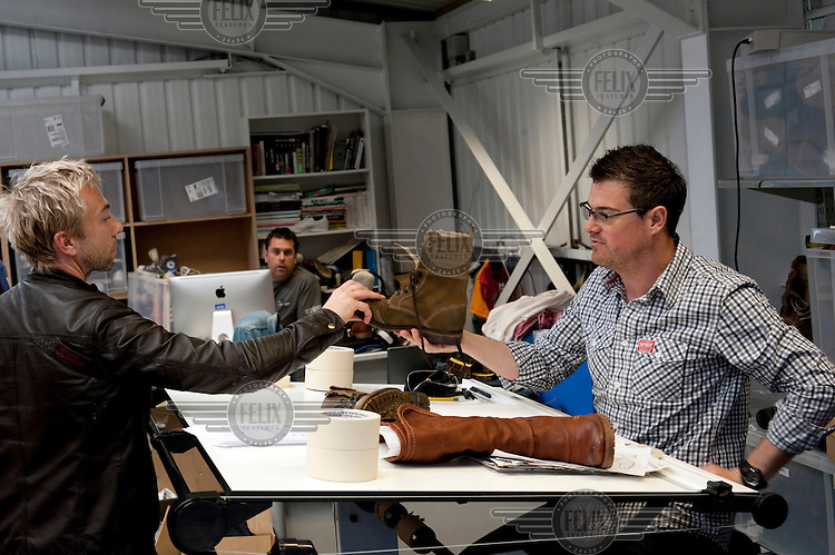 James Holder, left, discusses shoe products with designers at Superdry clothing brand's headquarters in Cheltenham.