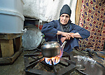 Ayush Nadir makes tea in her tent in a settlement of Syrian refugees in Minyara, a village in the Akkar district of northern Lebanon. Lebanon hosts some 1.5 million refugees from Syria, yet allows no large camps to be established. So refugees have moved into poor neighborhoods or established small informal settlements in border areas. International Orthodox Christian Charities, a member of the ACT Alliance, provides support for families in this settlement.