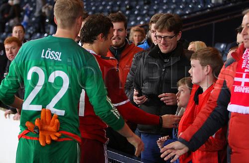 29.03.2016. Hampden Park, Glasgow, Scotland. International Football Friendly Scotland versus Denmark.  Jonas Lossl and Erik Sviatchenko greet Denmark fans in the stand