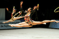 Spain rhythmic group split leaps to re-catch with clubs and hoops during event finals at 2006 Thiais Grand Prix in Paris, France on March 26, 2006. Lara Gonzalez is gymnast in foreground. (Photo by Tom Theobald)