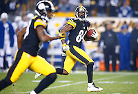 Antonio Brown #84 of the Pittsburgh Steelers runs back a punt for a touchdown in the fourth quarter against the Indianapolis Colts during the game at Heinz Field on December 6, 2015 in Pittsburgh, Pennsylvania. (Photo by Jared Wickerham/DKPittsburghSports)