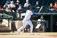 Surprise Saguaros shortstop Santiago Espinal (6), of the Toronto Blue Jays organization, hits a single to right field during an Arizona Fall League game against the Glendale Desert Dogs at Surprise Stadium on November 13, 2018 in Surprise, Arizona. Surprise defeated Glendale 9-2. (Zachary Lucy/Four Seam Images)