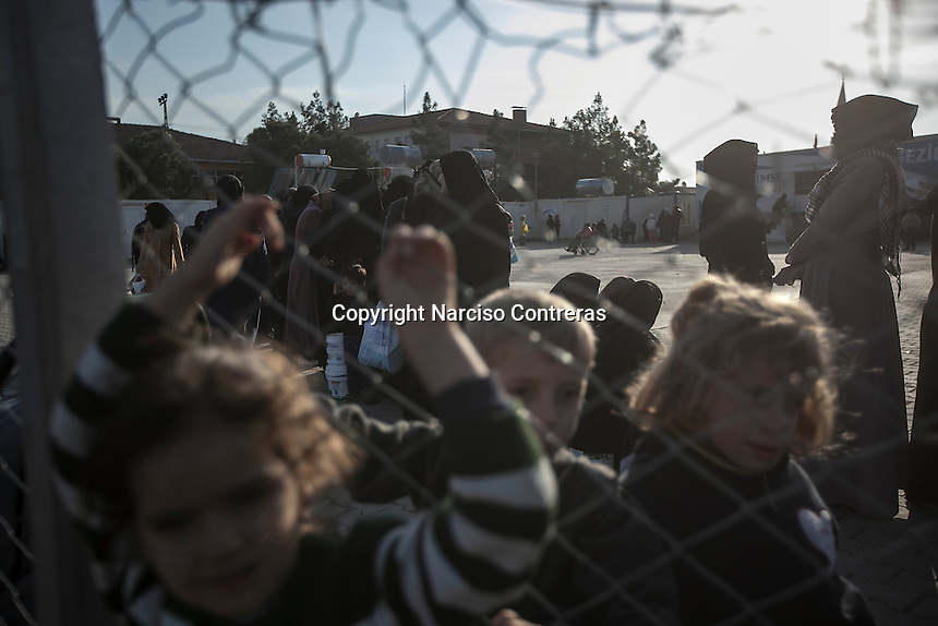 February 15, 2016: Syrian refugees line up as they await for food distribution at one neighbourhood in the outskirst of Kilis border town. The Kimse Yok Mu, a Turkish NGO, set up a kitchen to provide free meals to the thousands of refugees that have arrived from the war-torn Syria.