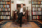 """Stephen Mihm poses for a portrait in his home in Decatur, Georgia March 31, 2013. Mihm wrote """"A Nation of Counterfeiters: Capitalists, Con Men, and the Making of the United States."""""""