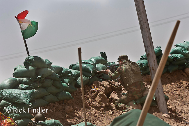 KIRKUK, KURDISTAN. 21.06.14 A sniper belonging to the Kurdish special forces takes aim during a small fire fight between Kurdish forces and ISIS militants in Basheer, southern Kirkuk.