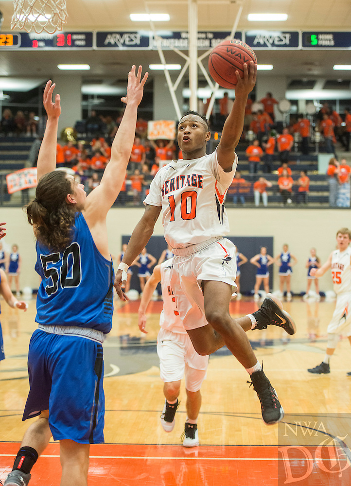 NWA Democrat-Gazette/ANTHONY REYES &bull; @NWATONYR<br /> Lexus Hobbs (10) of Rogers Heritage lays it in against Rogers Tuesday, Feb. 9, 2016 at War Eagle Arena in Rogers. Rogers Heritage won 42-36.