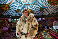 Mongolia, Bayan-Ulgii, Ulgii, Altai Mountains near Tsambagarav Mountain. Shaimurat, famous award winning eagle hunter and hids wife Gulzira at home in their yurt.