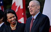 Washington, DC- October 11, 2008 -- United States Secretary of State Condoleeza Rice, left, and US Secretary of the Treasury Henry Paulson, right, were among those attending U.S. President George W. Bush, with G7 Finance Ministers and IMF Managing Director Dominique Strauss-Kahn, IMF President Robert Zoellick,  delivers remarks on the economy from the Rose Garden of the White House in Washington, D.C. USA 11 October 2008.  <br /> Credit: Chris Usher / Pool via CNP