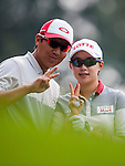 Hyo-Joo Kim (R) of Korea poses for photos during the Hyundai China Ladies Open 2014 on December 10 2014 at Mission Hills Shenzhen, in Shenzhen, China. Photo by Xaume Olleros / Power Sport Images