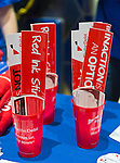 """Oct. 15, 2012 - Hempstead, New York, U.S. - Fix the Debt Campaign stickers with """"Red Ink Stinks"""" slogan and more are on table in lobby of Hofstra University's John Cranford Adams Playouse, while the campaign's co-founders, Simpson and Bowles, speak in the auditorium about ?America's Debt and Deficit Crisis: Issues and Solutions.? This event with the co-chairmen of the National Commission on Fiscal Responsibility and Reform, and co-leaders of Simpson-Bowles non-partisan U.S. fiscal debt reduction plan, was part of """"Debate 2012 Pride Politics and Policy"""" a series of events leading up to when Hofstra hosts the 2nd Presidential Debate between Obama and M. Romney, the next night, October 16, 2012, in a Town Meeting format."""