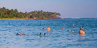Panoramic photo of tourists swimming at Mirissa Beach, South Coast of Sri Lanka, Asia. This is a panoramic photo of tourists swimming at Mirissa Beach, Sri Lanka, Asia. Mirissa Beach is a popular sandy tourist beach on the South Coast of Sri Lanka.