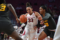 Arkansas' Chelsea Diungee drives to the basket while  Missouri's Nadia Green defends Sunday Jan. 12, 2020 at Bud Walton Arena in Fayetteville. The Hogs won 90-73.  <br /> Visit http://bit.ly/35LCcWr for a gallery of the game. (NWA Democrat-Gazette/J.T. Wampler)
