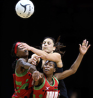 31.10.2013 Silver Fern Joline Henry and Malawi's Jessie Mazengera and Bridget Kumwenda in action during the Silver Ferns V Malawi during the New World Netball Series played at the Claudelands Arena in Hamilton. Mandatory Photo Credit ©Michael Bradley.