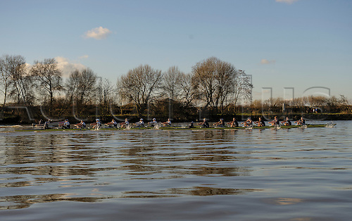 19.01.2014. River Thames, London, England. Both crews head to head during the Oxford University Boat Club Trial VIIIs. Stubborn VIII [Blue Shirts] John Redos [Bow], Tom Watson [2], Joseph Dawson [3], James Mountain [4], Karl Hudspith [5], Nicholas Hazell [6], Sam O'Connor [7], Constantine Louloudis [Stroke], Sophie Shawdon [Cox], Persistant VIII [White Shirts] Dominic Parr [Bow], Matthias Wyss [2], James Fraser-Mackenzie [3], Thomas Swartz [4], Malcolm Howard [5], Michael Di Santo [6], Iain Mandale [7], Chris Fairweather [Stroke], Laurence Harvey [Cox] The Trial serves as part of the selection process to determine who will represent Oxford University in the 160th running of the University Boat Race on April 6th 2014. The trial for the two eights, named Persistent and Stubborn is the only occasion during the season that the squad members can race side-by-side over the full four and a quarter miles of the Championship Course between Putney and Mortlake in a simulation of The BNY Mellon Boat Race.