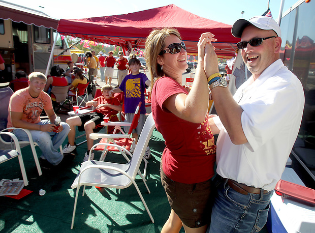 Heather Jacobs dances with her boyfriend, Dan Moen, while Moen's sons watch during a tailgate before an Iowa State football game in October. Heather lost her husband, Eric, in a plane crash in 2006 when she was eight months pregnant with their youngest, Ella, and has since been raising her five young children on her own.