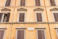 Colorful old building with shuttered windows, Rome, Italy
