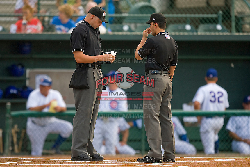 Home plate umpire Brandon Henson (L) and base umpire Roberto Medina meet at home plate prior to the start of the Florida State League game between the Dunedin Blue Jays and the Daytona Cubs at Jackie Robinson Stadium June 18, 2010, in Daytona Beach, Florida.  Photo by Brian Westerholt /  Seam Images
