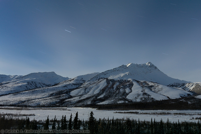 Moonlight over the foothill mountains of the Brooks range, Dietrich river in foreground, Arctic Alaska